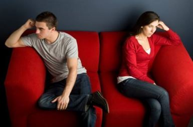 couple-fighting-on-couch-550x365
